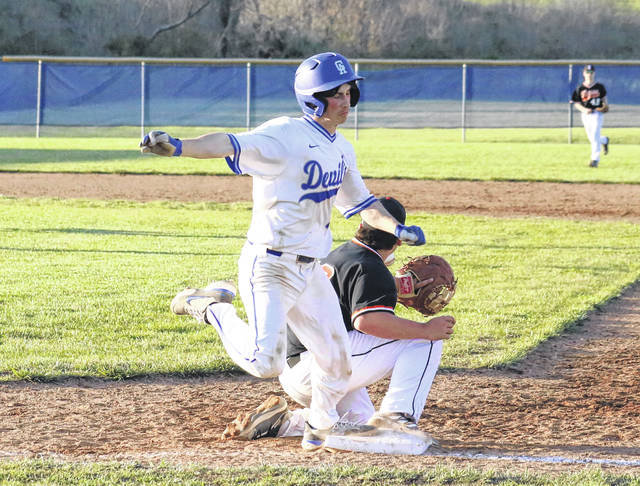 Gallia Academy's Dalton Mershon steps safely on first base, during the Blue Devils' 7-4 loss to Ironton on Friday in Centenary, Ohio.