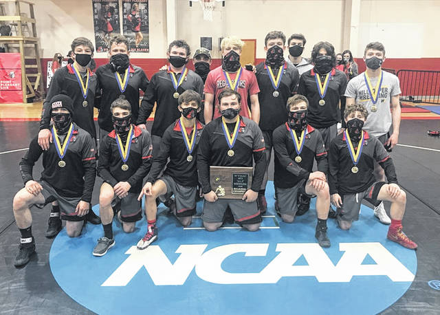 Members of the Point Pleasant wrestling team pose for a picture after capturing the 2021 Class AA-A Region IV championship on Friday in Point Pleasant, W.Va.