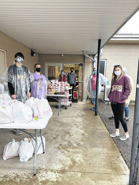 Volunteers helping with the first distribution at the Meigs County Schools Food Pantry included, (left to right) Jack Musser, Cameron Davis, Jennifer Sheets, James Sheets, Barbara Musser, Chrissy Musser (partially hidden), and Maggie Musser.