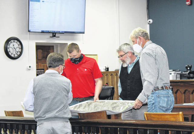 Engineer Craig Richards shows Meigs County Commissioners Jimmy Will, Shannon Miller and Tim Ihle the proposed area for sewer expansion.
