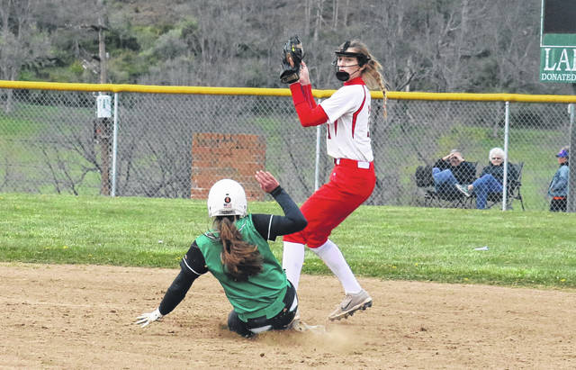 Wahama senior Emma Gibbs steps on second base for a force out on Eastern's Megan Maxon, during the Lady Falcons' 17-0 season-opening victory on Friday in Tuppers Plains, Ohio.