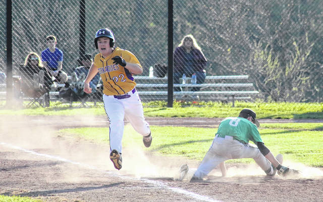 SHS junior Tanner Lisle (22) safely reaches first base behind Waterford's Gavin Brooker (8), during the Wildcats' 9-1 victory on Monday in Racine, Ohio.