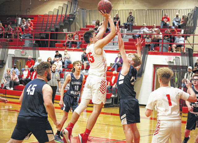 Wahama's Harrison Panko-Shields shoots a two-pointer over Hannan's J.W. Adkins, during the second quarter of the Class A Region IV, Section 2 tournament opener on Tuesday in Mason, W.Va.