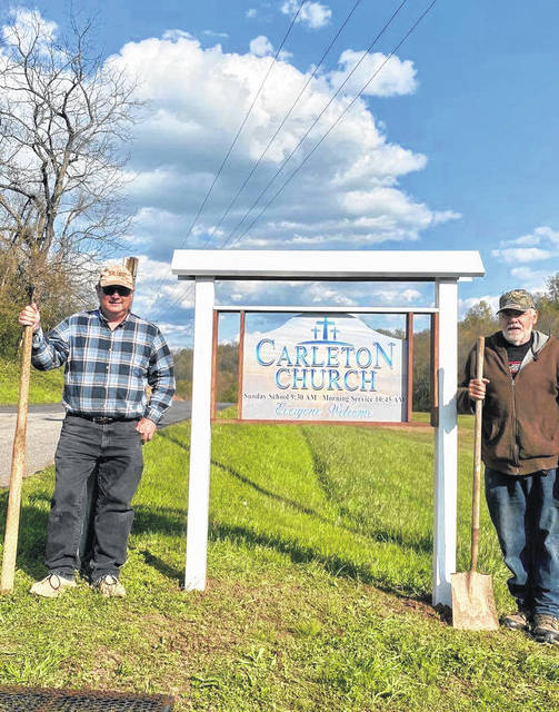The Dean Family recently made and donated a new sign for Carleton Church. Pastor Jimmie Evans, of the Carleton Church, is pictured with John Dean after the new sign was placed. The Carleton Church is located on Kingsbury Road, C.R. 18, Pomeroy. Services include 9:30 a.m. Sunday School, and 10:45 a.m. Sunday morning worship service.