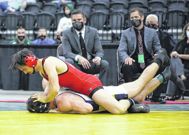 Point Pleasant senior Mitchell Freeman pushes an opponent's face into the mat during the 152-pound championship match on Thursday at the Class AA-A state wrestling tournament in Huntington, W.Va.