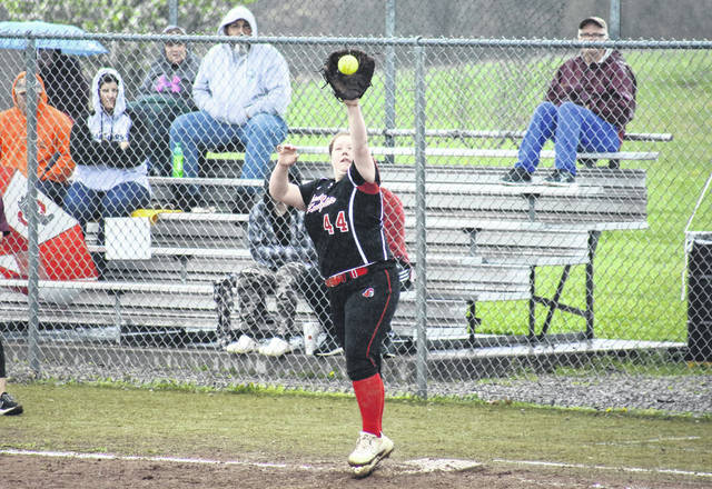 Point Pleasant's Krysten Stroud (44) makes a grab at first base, during the Lady Knights' season-opening win on April 12 in Rocksprings, Ohio.
