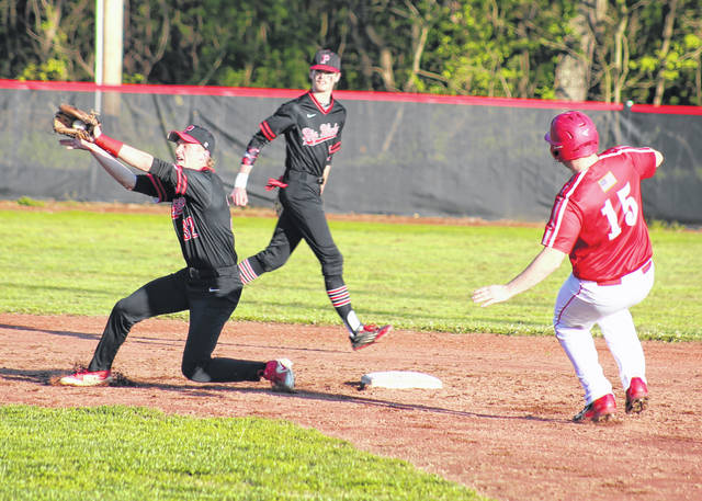Point Pleasant second baseman Hunter Bush, left, receives a throw as Wahama's Michael VanMatre (15) starts his slide into the bag during the third inning of Monday night's baseball game in Point Pleasant, W.Va.