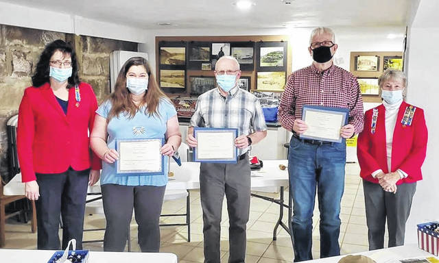Regent Gina Tillis presents awards to Jocelyn Johnson for military service, Jim Freeman for work in conservation, and Michael Gerlach for contributions in local history. Chapter Registrar Opal Grueser assisted in the presentations.