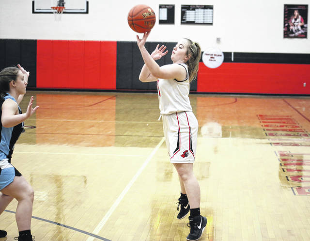 PPHS sophomore Matti Fields (right) shoots a three-pointer, during the fourth quarter of the Lady Knights' 49-21 setback on Thursday in Point Pleasant, W.Va.
