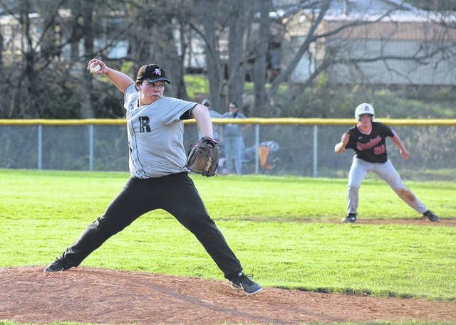 River Valley sophomore reliever Garrett Facemire, left, delivers a pitch during the seventh inning of Wednesday night's TVC Ohio baseball contest against Alexander in Bidwell, Ohio.
