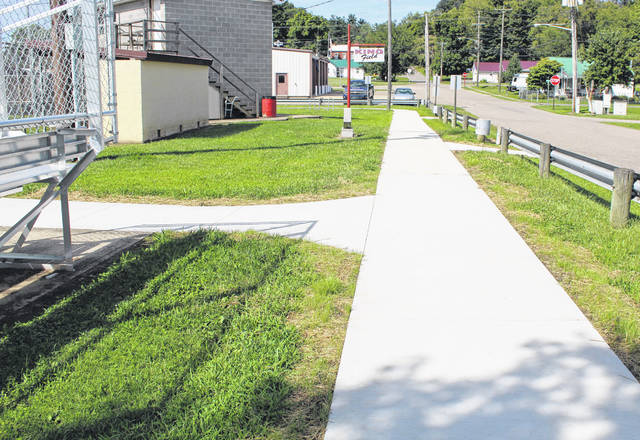 New sidewalks were placed at the Syracuse Municipal Park as part of the Creating Health Communities Program at the Meigs County Health Department.