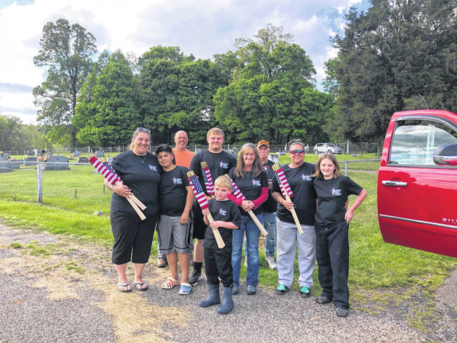 4Fun 4-H and Tuppers Plains VFW 9053 teamed up to put American flags on Veterans graves at Sandhill and Reedsville Cemeteries in advance of Memorial Day.