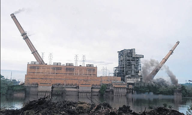 The two stacks on the former Philip Sporn Plant can be seen falling during Monday's demolition.