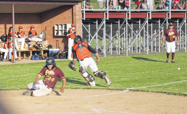 Meigs' Lucas Finlaw (24) slides in home behind Belpre's Matt Bayne (17) for the go-ahead run in the Marauders' 6-4 victory in the Division III sectional semifinal on Wednesday in Rocksprings, Ohio.