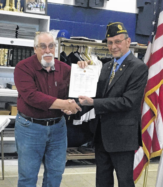 Allen Downie is pictured with Commander John Hood. Downie was recognized for 50 years of membership.