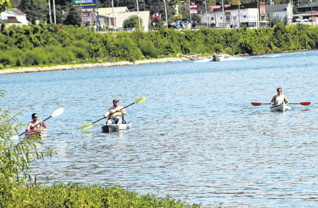 Kayakers approach the Pomeroy levee during the 2020 Pomeroy Sternwheel Regatta.