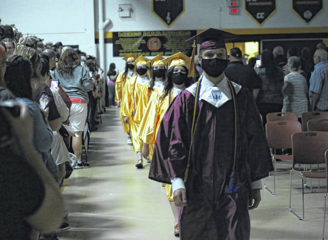 Valedictorian Nicholas McConnell leads the Meigs High School Class of 2021 into the gymnasium on Friday evening.