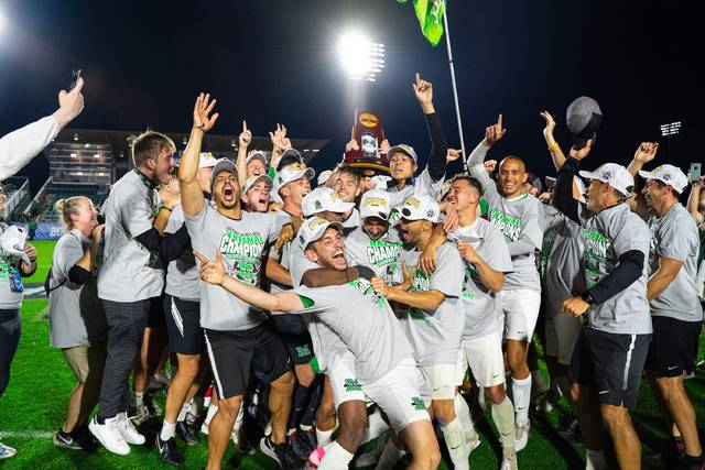 Marshall beat Indiana to win its first-ever College Cup championship 1-0 in overtime Monday night. Pictured are team members with the trophy shortly after the game ended. This photo provided by Marshall University.