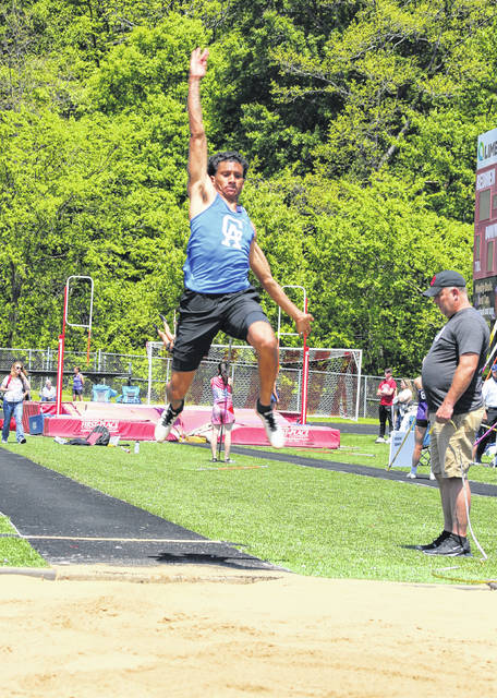 Gallia Academy junior Daunevyn Woodson leaps through the air during an attempt in the long jump event held at the Ohio Valley Conference Championships on Saturday, May 15, at Rock Hill High School in Pedro, Ohio.