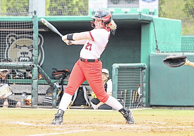 Rio Grande's Taylor Webb follows through with her swing after connecting for a first inning double in Monday's 4-0 loss to Milligan (Tenn.) University in the NAIA Softball National Championship Opening Round at the Grizzly Softball Complex in Lawrenceville, Ga.