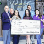 OVB presents donation to Square One womens' domestic violence shelter
