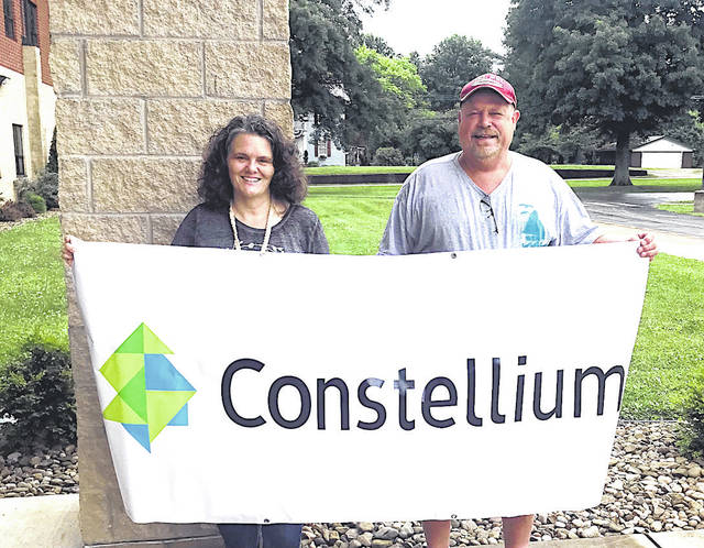 Constellium recently made a donation to the Southern Local School District's Athletic Department as part of a program to purchase AED's for the school's gyms and field house. This is part of a larger plan to improve and maintain the athletic program which is somewhat crippled financially due to the pandemic. Pictured here holding the Constellium banner are (left to right) Tricia McNickle, Elementary Principal and Scott Wolfe, Grants Administrator and Fundraising Organizer. Southern wishes to thank the folks at Constellium for their generous donation. Part of the fundraising plan includes getting AED defibrillators for all of the athletic facilities at Southern. Donations are still being sought as part of the athletic department campaign at Southern Local Athletics Donations, Attn: Scott Wolfe; 920 Elm Street, Racine, Ohio 45771. No donation is too small.