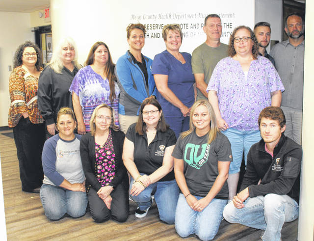 Meigs County Health Department staff members are pictured during a group photo last week. The health department was recognized by the local DAR chapter for their work during the past year.