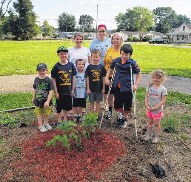 Middleport Cub Scout Pack 777 recently planted a tree at Middleport Village Hall. Pictured are Kazden Pearson, Hunter Pearson, Blake Bolin, Turner Bolin, Logan Chaffee, Dakota Chaffee, Den Leaders Bethany Bolin and Holly Chaffee, and Cub Master Brenda Neutzling. Middleport Cub Scout Pack 777 is open to all Meigs County children in Kindergarten through 5th grade. The next Cub Scout event is at Star Mill Park on July 16th. Families interested in joining Cub Scouts can contact Brenda Neutzling via text at 740-416-0198.