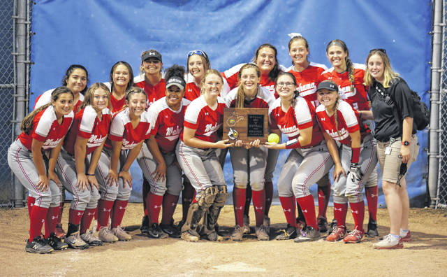 Members of the 2021 Wahama softball team pose with the Class A, Region IV championship trophy, after an 11-4 extra-innings victory on Wednesday in Man, W.Va.