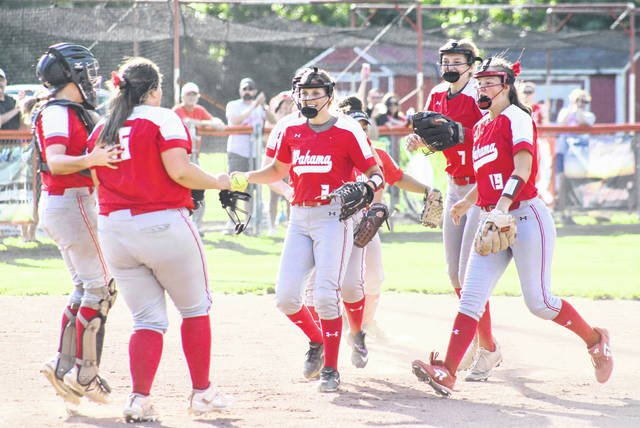 Members of the Wahama infield celebrate a double-play, during the Lady Falcons' 2-0 victory over Man on June 15 in Hartford, W.Va.