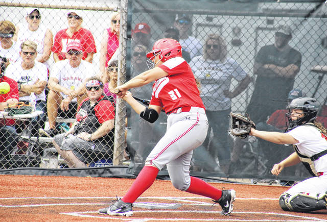WHS sophomore Morgan Christian (31) blasts a three-run home run, giving the Lady Falcons the lead over Petersburg, during the Class A state tournament on Tuesday at Little Creek Park in South Charleston, W.Va.