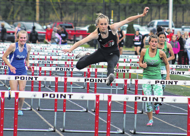 Point Pleasant junior Elicia Wood, middle, clears an obstacle while pulling away from the field during the 100-meter hurdles race at the Paul Wood Memorial Invitational held on May 7 at Ohio Valley Bank Track and Field in Point Pleasant, W.Va.