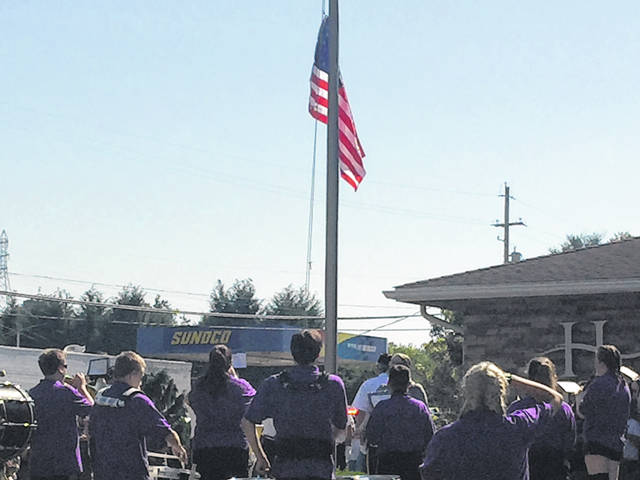 The Southern Marching Band plays during the flag raising at Home National Bank during the Racine parade.