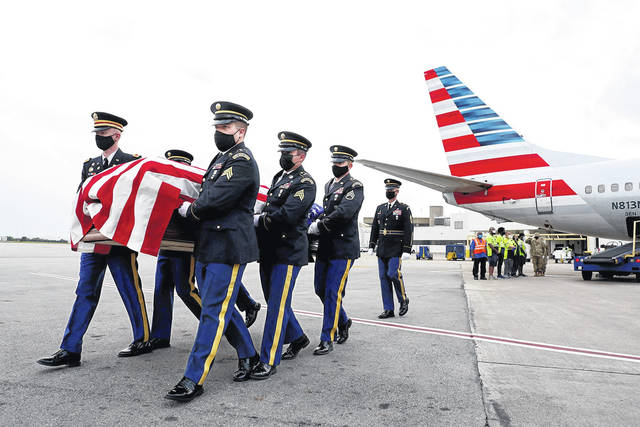 An Ohio Army National Guard Honor Guard carries a casket containing the remains of Army Pfc. James Wilmer White on Tuesday night. Photo by Fred Squillante | Columbus Dispatch