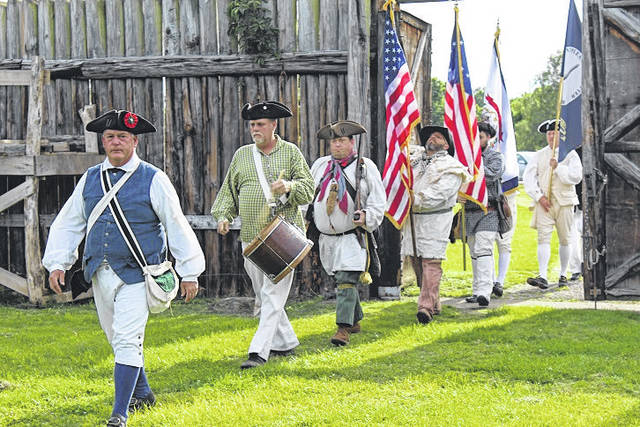 The colour guard from the Sons of the American Revolution at a previous event at Fort Randolph.