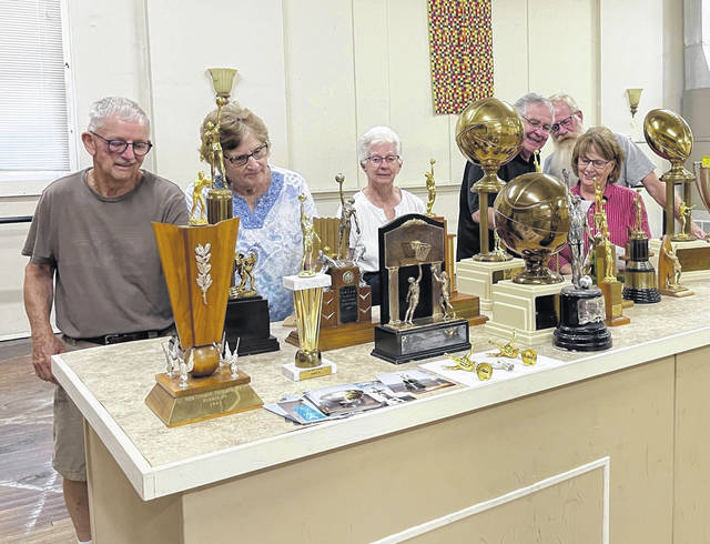 The Middleport Trophy Case Committee members are pictured with some of the trophies. Pictured, L to R, are Eddie Crooks, Judy Crooks, Mary Wise, John Blake, Don Stivers, and Margie Blake.