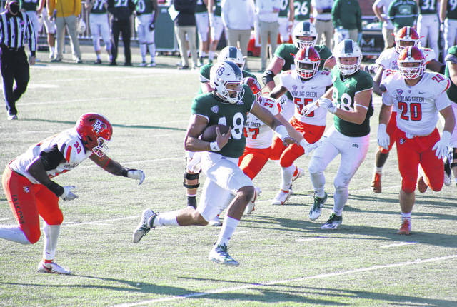 Ohio quarterback Armani Rogers (18) splits the BGSU defense on his way to the end zone, during a Nov. 28, 2020 game at Peden Stadium in Athens, Ohio. (Alex Hawley|OVP Sports)