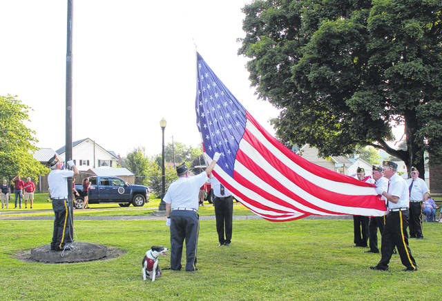 American Legion Feeney Bennett Post 128 conducted the flag raising following the parade in Middleport on Sunday evening.