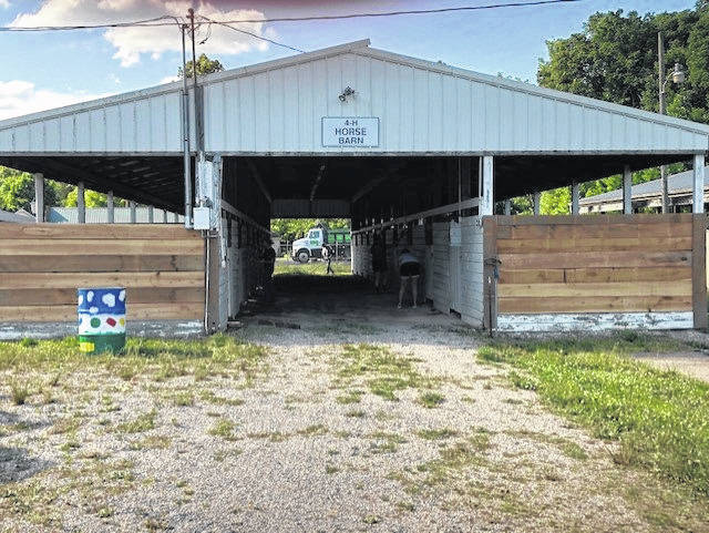 The 4-H Horse Barn received new boards placed on the front.