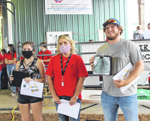 In this photo from last year's fair, Rachel Jackson and Coltin Parker were named the 2020 Meigs County Outstanding 4-H members. Jackson (left) and Parker (right) are pictured with 4-H Educator Nancy Sydenstricker.