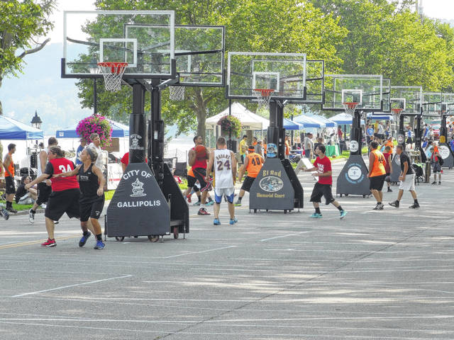 Players compete during a previous Hoop Project weekend along First Avenue in Gallipolis. The event returns this Saturday and Sunday.
