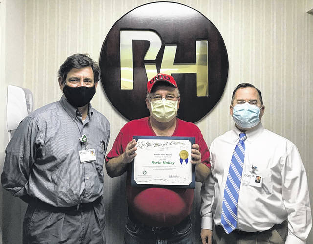 Kevin Halley is pictured with Tony Hempill, housekeeping manager, and Jeff Noblin, FACHE, PVH CEO.