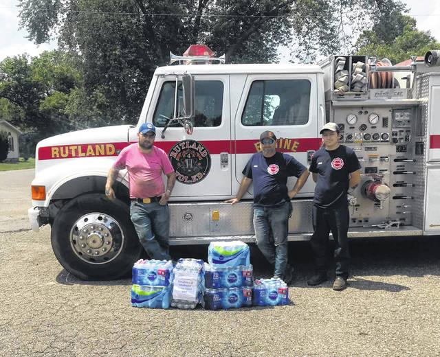 Middleport Fireman and Member of Middleport Lodge 363 Jesse Pullins (left) delivered donated cases of water to Rutland Firemen Donnie Tillis (center) and Travis Painter (right). The water collected by member of Middleport Masonic Lodge 363 were given as a donation to the Rutland Fire Department. Members were very thankful for the donation of water. July and August are the two months when firemen are most likely to experience heat exhaustion or worse a heat stroke. The water is to hopefully help combat the possibility of that happening.