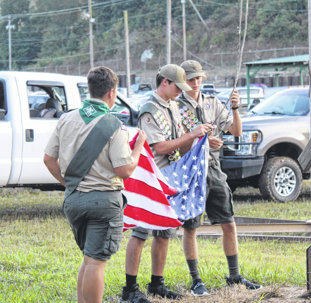 Eagle Scouts Ethan Short, Colton McDaniel and Cooper Schagel presented the colors during the opening ceremony on Sunday evening.