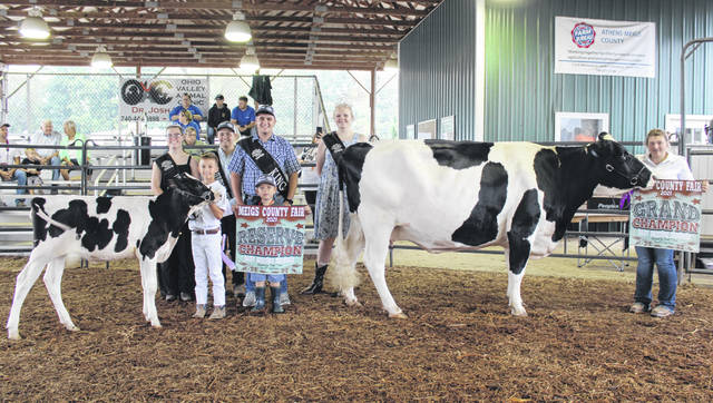 Caelin Seth was named the Grand Champion Dairy Showman and Porter Webb the Reserve Champion Dairy Showman during Monday's Meigs County Fair Dairy Show. Also pictured are Meigs County Fair Royalty Livestock Princess Lizzie Parry
