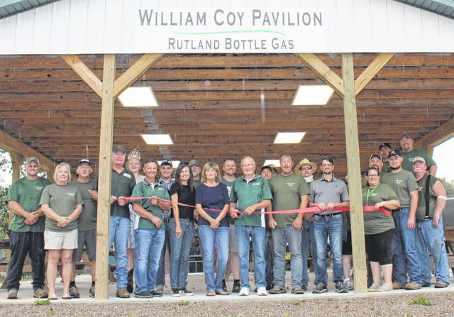 """The William Coy Pavilion by Rutland Bottle Gas at the Meigs County Fair was officially dedicated on Monday, with Coy cutting the ribbon for the opening. The pavilion honors William """"Bill"""" Coy who has worked for Rutland Bottle Gas for 62 years. The new structure provides a covered eating area for those attending the Meigs County Fair and other activities on the fairgrounds. Pictured are Rutland Bottle Gas and Meigs County Fair Board representatives, with Coy in the center."""