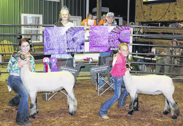 Jennifer Parker was named the Grand Champion and Reagan Burke the Reserve Champion during Monday night's Market Sheep Show. Also pictured are Meigs County Fair Queen Olivia Harris and Meigs County Fair King Jacob Spencer.