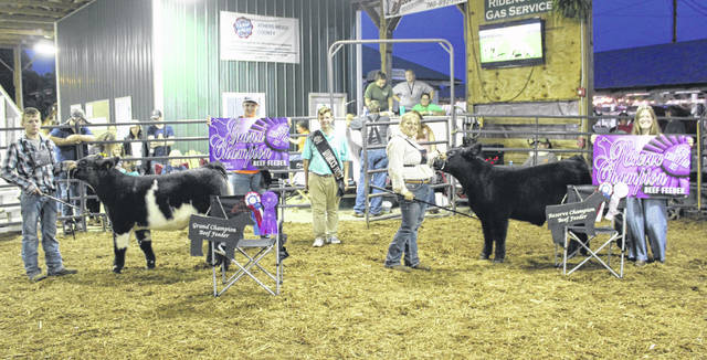 Zachary Williams (left) showed the Grand Champion Beef Feeder and McKenzie Long (second from right) showed the Reserve Champion Beef Feeder. Also pictured are Meigs County Fair Royalty King Jacob Spencer, Livestock Prince Jacob Fitch, and Livestock Princess Lizzie Parry.