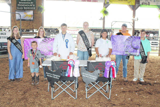 Gabriel Folmer (third from right) showed the Grand Champion Market Chickens, with Corey Seth (fourth from left) showing the Reserve Champion Market Chickens. Pictured with Folmer and Seth are Meigs County Fair Royalty Livestock Princess Lizzie Parry, Little Mister Meigs County Everett Lee, Fair Queen First Runner Up Shelbe Cochran, Fair Queen Olivia Harris, Fair King Jacob Spencer and Livestock Prince Jacob Fitch.