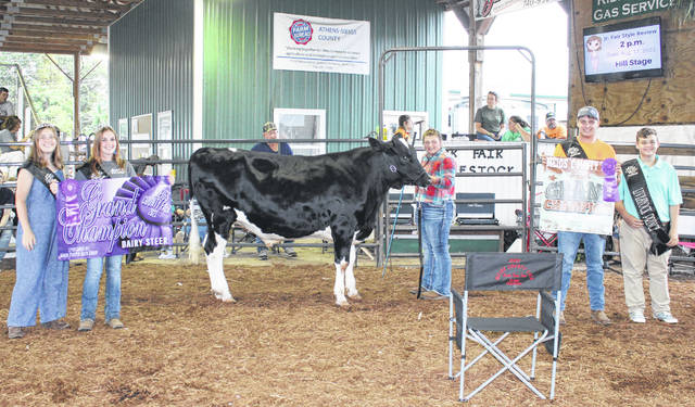 Caelin Seth took the top spot in the Dairy Steer Show for both showmanship and market. Also pictured are Meigs County Fair Royalty Livestock Princess Lizzie Parry, Queen First Runner Up Shelbe Cochran, King Jacob Spencer and Livestock Prince Jacob Fitch.